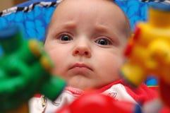 Bebê com os chocalhos de suspensão Foto de Stock Royalty Free
