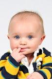 Bebê com os dedos na boca foto de stock