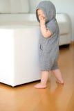 Bebê com os olhos azuis que vestem o hoodie Imagem de Stock Royalty Free