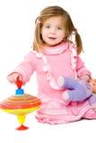 Bebê com parte superior de giro Foto de Stock Royalty Free