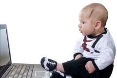 Bebê com a perplexidade que olha Imagem de Stock Royalty Free