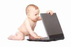 Bebê com portátil Fotografia de Stock