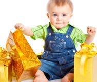Bebê com presentes Imagens de Stock