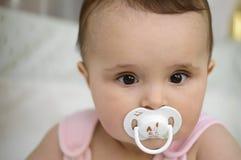 Bebê com soother Foto de Stock