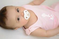 Bebê com soother Imagens de Stock Royalty Free