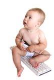 Bebê com teclado e rato Imagens de Stock