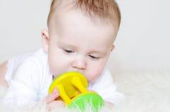 Bebê com um chocalho Fotos de Stock Royalty Free