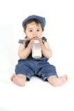 Bebê com um frasco de leite fotos de stock royalty free
