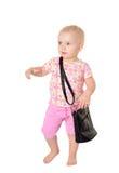 Bebê com um saco no fundo branco Fotos de Stock Royalty Free