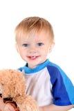Bebê com urso de peluche Imagens de Stock