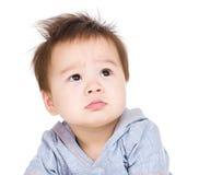 Bebê confuso foto de stock