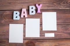Bebê da palavra e foto branca do quadro Fotografia de Stock Royalty Free