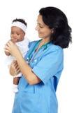Bebê da terra arrendada da enfermeira Imagem de Stock