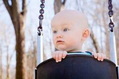 Bebê de balanço curioso imagens de stock royalty free