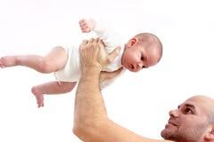 Bebê de levantamento do pai acima Imagem de Stock Royalty Free
