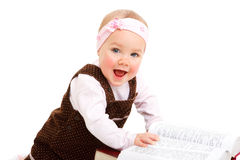 Bebê de riso com livro Imagens de Stock Royalty Free