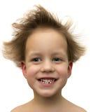 Bebê de sorriso bonito com o cabelo de colagem-para fora isolado no branco. Imagem de Stock