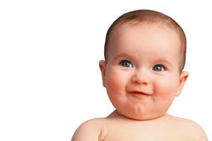Bebê de sorriso bonito com olhos azuis abertos perto acima Fotos de Stock