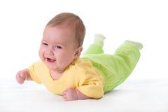 Bebê de sorriso na cama Fotos de Stock Royalty Free