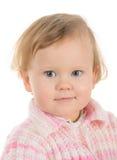 Bebê de sorriso na cor-de-rosa Fotografia de Stock
