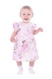 Bebê de sorriso pequeno no vestido cor-de-rosa Fotos de Stock Royalty Free