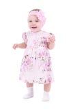 Bebê de sorriso pequeno no vestido cor-de-rosa Imagens de Stock Royalty Free