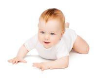 Bebê de sorriso que encontra-se no assoalho fotos de stock royalty free