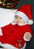 Bebê do Natal com um fundo da árvore de Natal Foto de Stock