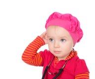 Bebé com o phonendoscope isolado em um fundo branco Fotografia de Stock