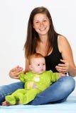 Bebê e baby-sitter Imagem de Stock