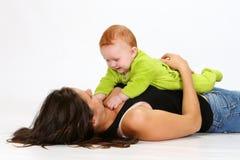Bebê e baby-sitter Imagens de Stock