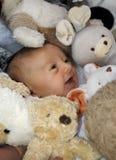 Bebê e brinquedos 2 fotos de stock