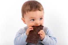 Bebê e chocolate Fotografia de Stock