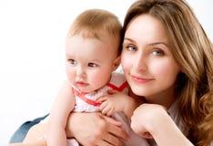 Bebê e mãe fotografia de stock