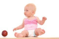 Bebê e maçã Fotografia de Stock