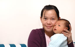 Bebê e matriz Fotos de Stock