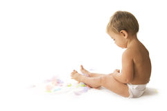 Bebê e penas Fotografia de Stock Royalty Free