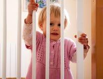 Bebê e a porta da escada Fotos de Stock Royalty Free
