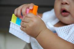 Bebê e seu brinquedo Fotografia de Stock Royalty Free