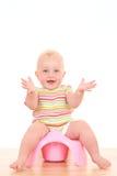 Bebê em potty Fotos de Stock