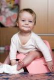 Bebê em seu potty foto de stock royalty free