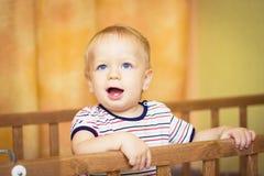 Bebê em um berço Imagens de Stock Royalty Free