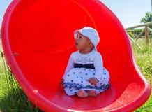 Bebê em um campo de jogos Fotografia de Stock Royalty Free