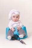 Bebê em um equipamento do cozinheiro chefe Imagens de Stock Royalty Free