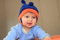 Bebê encantador que tenta rastejar fotografia de stock royalty free