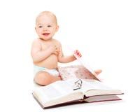 Bebê feliz com livros Fotografia de Stock Royalty Free