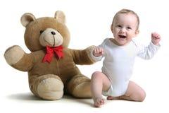 bebê feliz com urso de peluche Fotografia de Stock Royalty Free