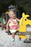 Bebê feliz no campo de jogos imagem de stock