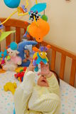 Bebê feliz que joga com brinquedos Foto de Stock Royalty Free