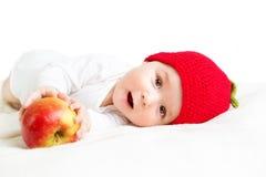 Bebê idoso de sete meses com maçãs Imagem de Stock